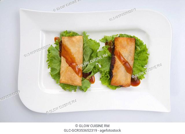 Stuffed spring rolls with green lettuce