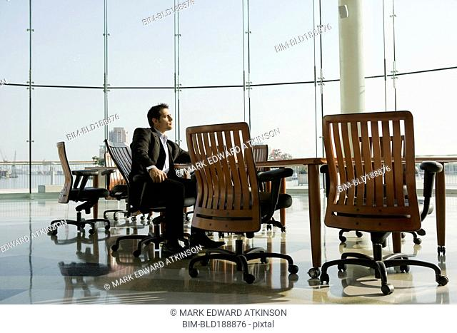 Businessman waiting in conference room for meeting