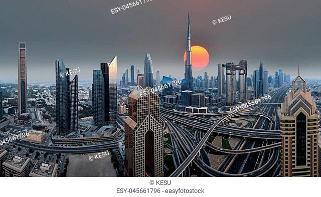 Dubai skyline during sunrise with heavy traffic road, United Arab Emirates