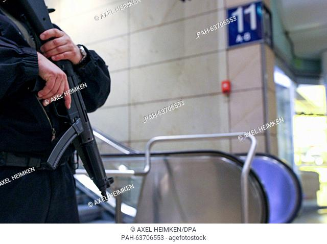 A policeman stands guard at a cordoned off platform at the main train station in Hanover, Germany, 17 November 2015. A suspicious package was found on a train...