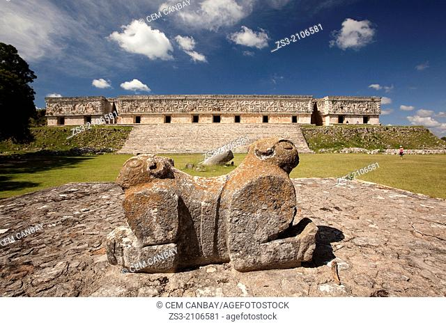 Jaguar sculpture with the Governor's Palace at the background, Prehispanic Mayan city of Uxmal Archaeological Site, Yucatan Province, Mexico, North America