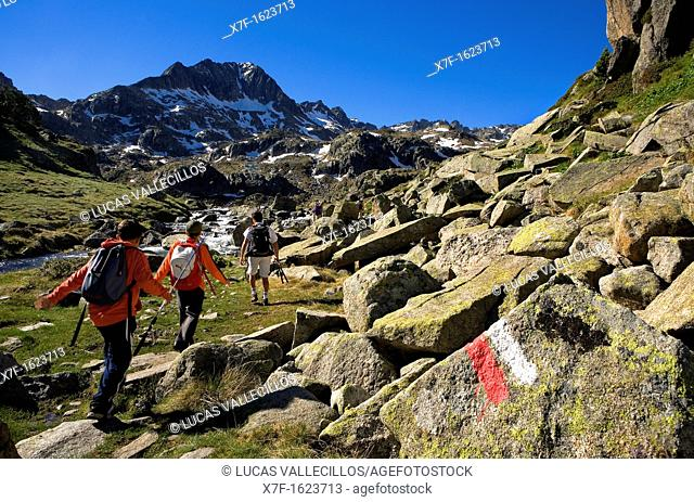 Trippers and Signposting of GR-11 in Circ de Colomers, near Obago lake,Aran Valley, Aigüestortes and Estany de Sant Maurici National Park,Pyrenees