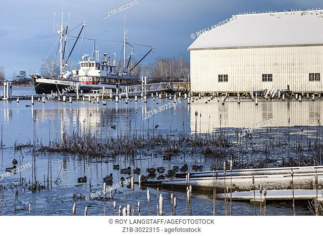 Heritage net loft building on the banks of the Fraser River in Steveston, Canada
