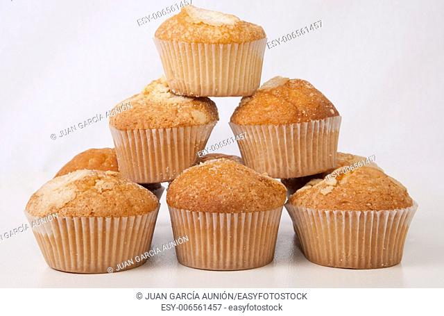 Traditional madeleines made with olive oil. Spanish typical small cake. Isolated over white background