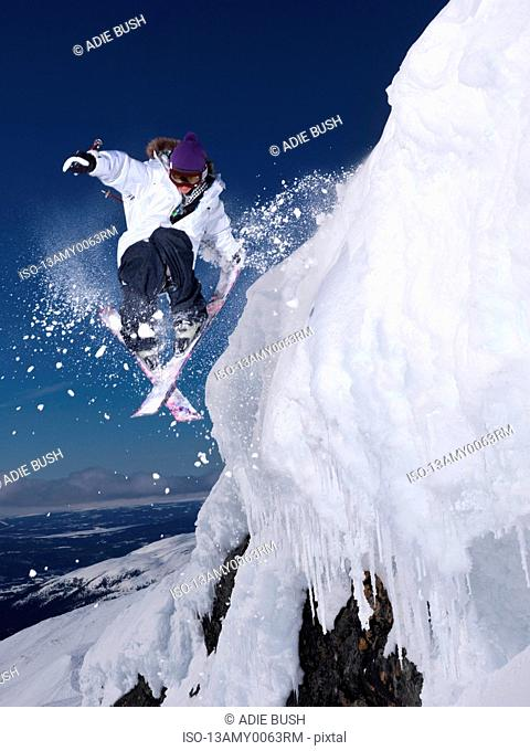 Man grabbing ski tail mid air