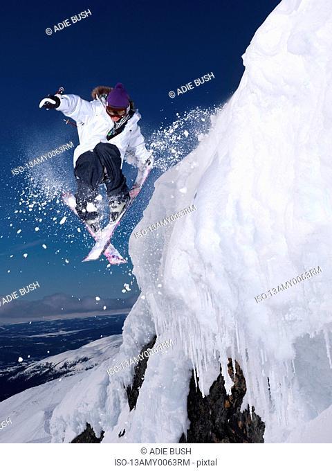 Man grabbing ski tail mid air