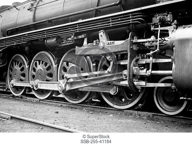 Close-up of the wheels of a steam train