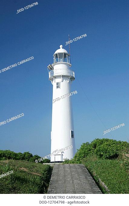 South America, Brazil, Parana, Ilha do Mel, Farol das Conchas, View of lighthouse on verdant island
