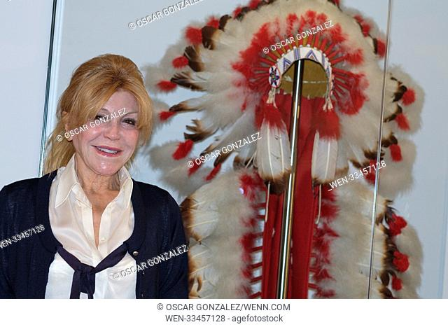 Baroness Carmen Thyssen Bornemisza donates a feathered headdress of the North American native cultures to the National Museum of Anthropology
