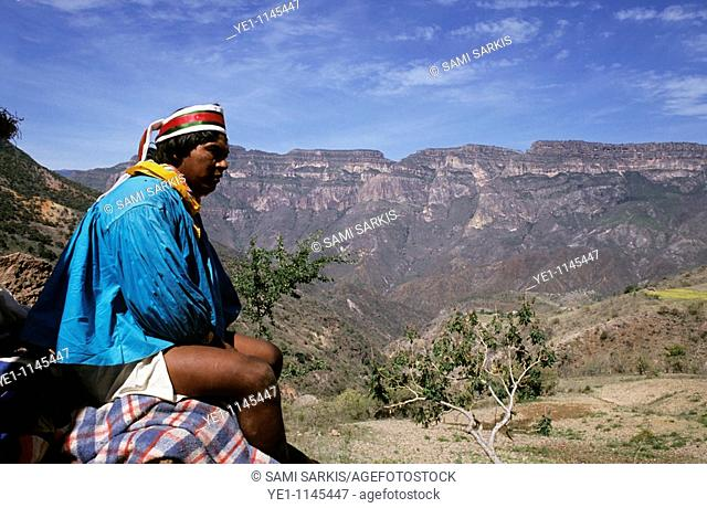 Tarahumaran Indian looks out onto the Sierra Madre Mountains, Mexico