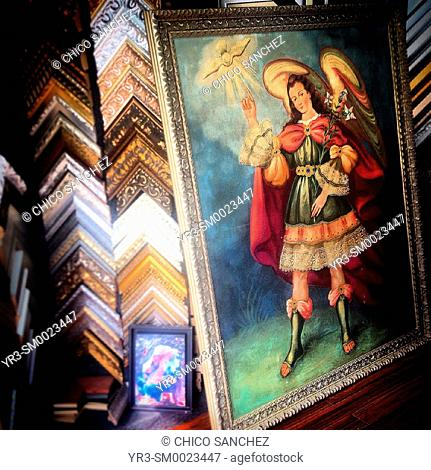 An image of an Archangel and the Holy Spirit decorates a shop in Mexico City, Mexico