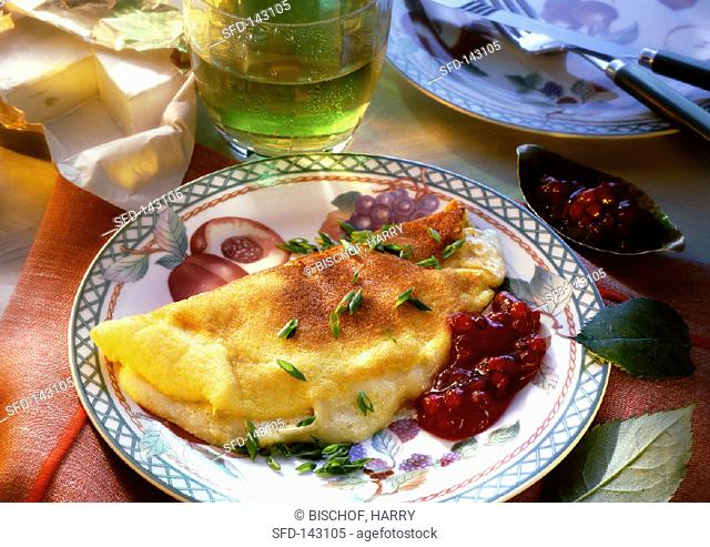Omelette with camembert filling and cranberries