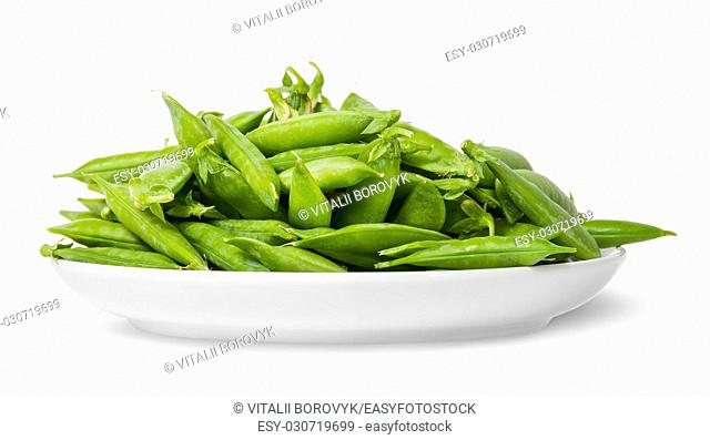 Pile of green peas in pods on white plate isolated on white background