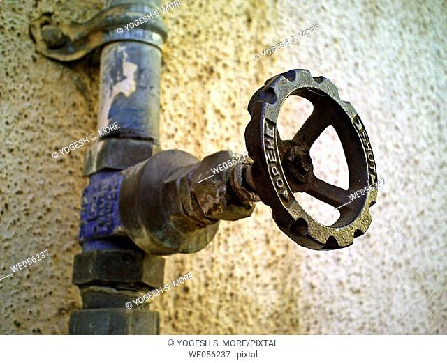 A revolving cock, tap of a water pipeline going to an overhead water storage on a building teracce  Pune, Maharashtra, India