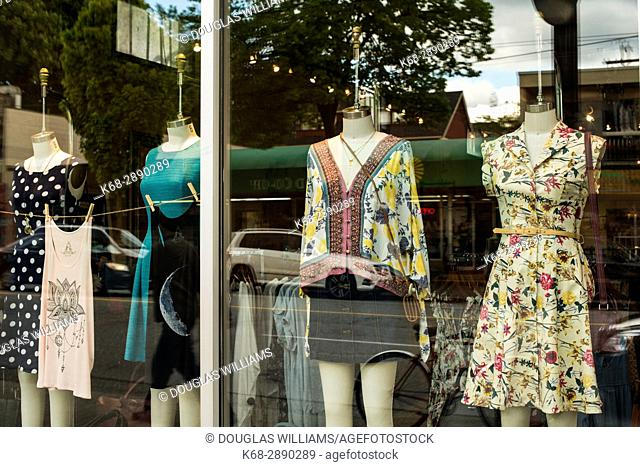 Women's clothing in a shop window on Commercial Drive, Vancouver, BC, Canada
