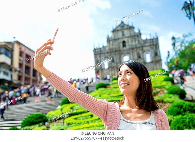 woman taking self image in Macau city