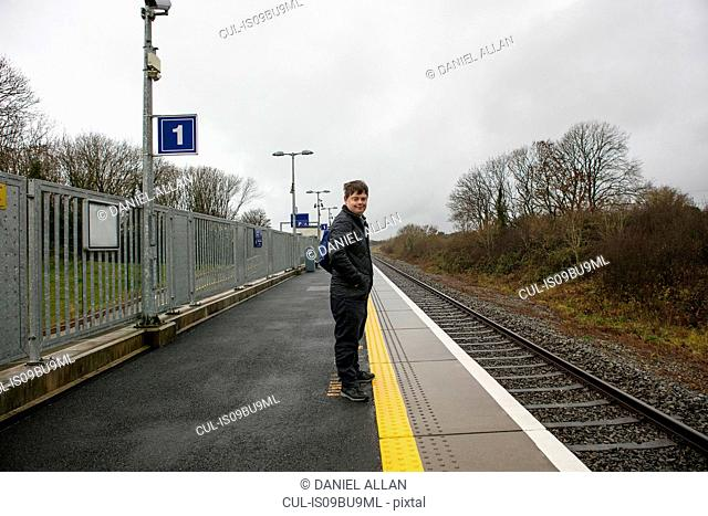 Man with down syndrome on platform in train station, Galway, Ireland