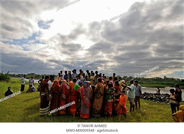 Victims of the cyclone SIDR gathers on the river bank with the hope to get some aid SIDR hits the village on the night of 15th November causing huge damage of...