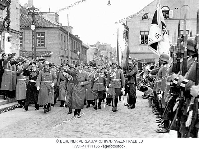 Reich Chancellor Adolf Hitler walks past an honorary company in Memel (today: Klaipeda/Lithuania) on the occasion of the handing over of the Memel Country by...
