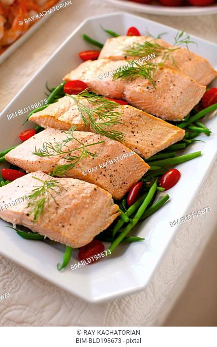 Salmon fillets on green beans