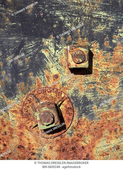 Rusty bolts and weathered colours on a wagon, ghost town of Rhyolite, Nevada, USA
