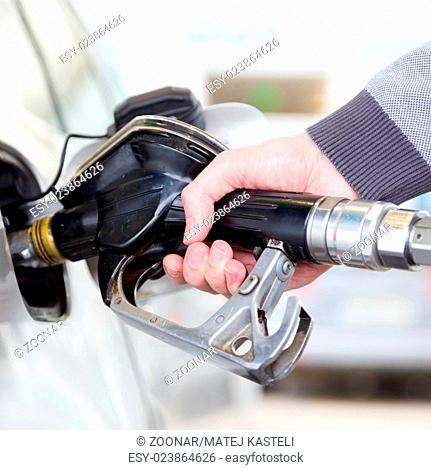 Petrol being pumped into a motor vehicle car