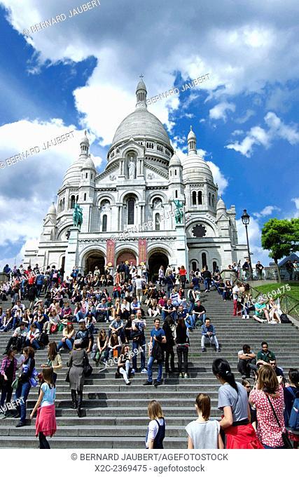 France. Paris. Sacre Coeur Basilica, Montmartre, Paris, France with tourists on the steps