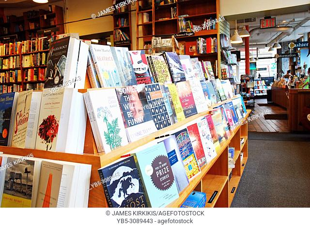 A shelf full of novels is on display at the Harvard Bookstore, in Cambridge, Massachusetts