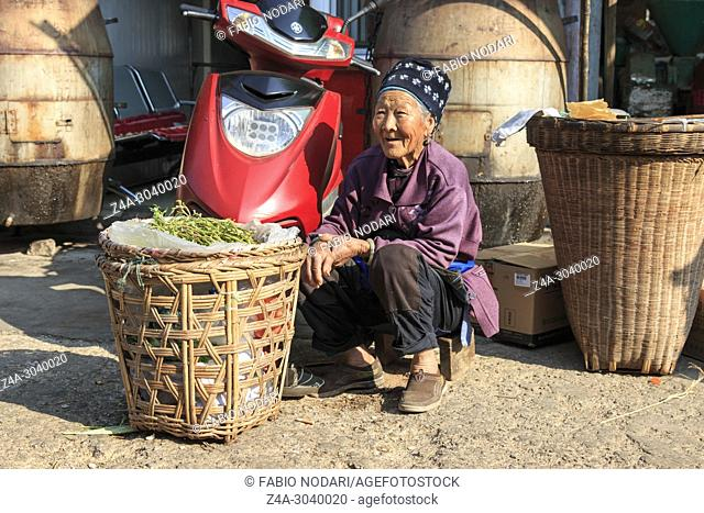 Chinese woman in a local market in Xizhou close to Dali Old Town in Yunnan