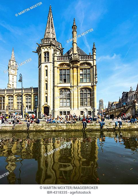 Leie River and promenade on the Graslei, old post office, young people on the shore, Ghent, Flanders, Belgium