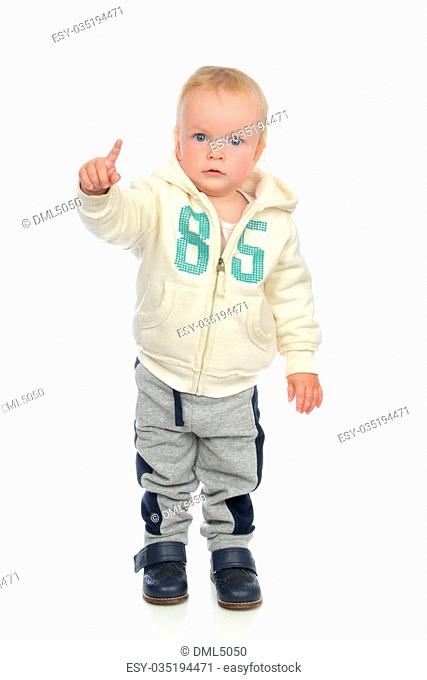 Happy child baby blue eyes toddler pointing finger smiling isolated on a white background
