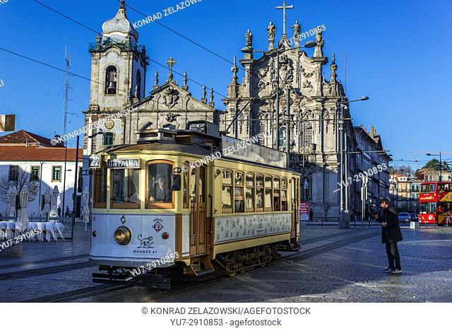 Vintage tram in front of Carmelite Church (Igreja dos Carmelitas Descalcos) and Carmo Church (Igreja do Carmo) in Vitoria parish of Porto, Portugal