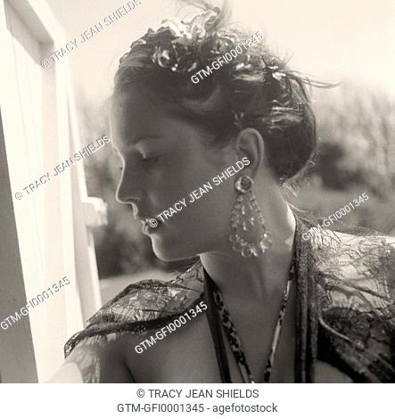 Profile of young woman with large earrings