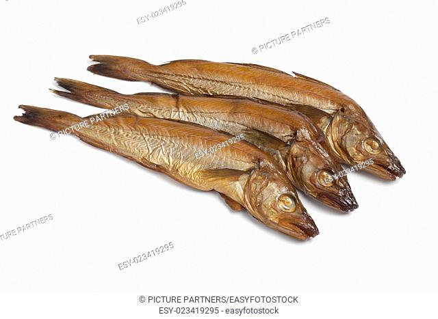 Fresh smoked whiting fish on white background