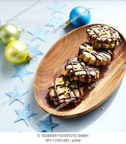 Christmas cookies filled with jam and drizzled with chocolate