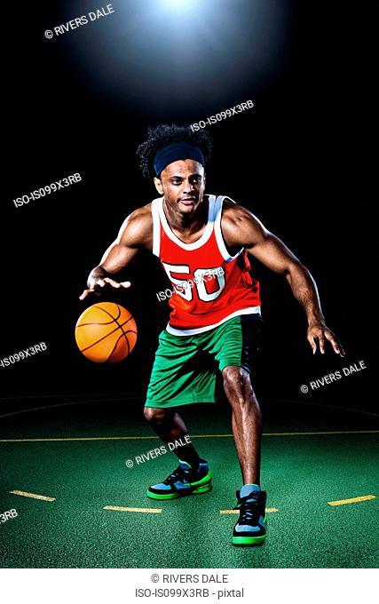 Basketball player bouncing ball