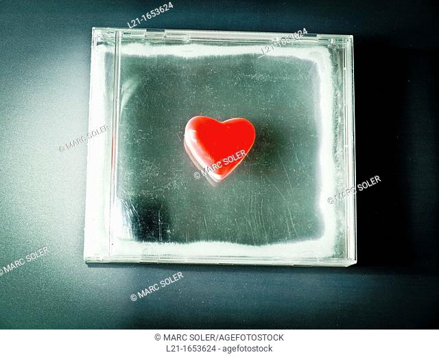 Red heart in a plastic square box