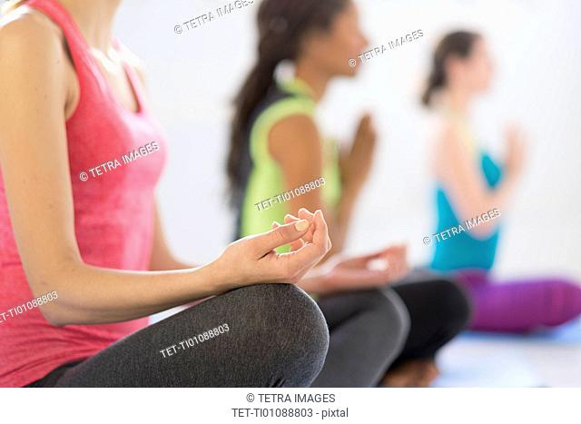 Women in lotus position meditating