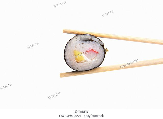 Japanese sushi rolls with wooden chopsticks isolated