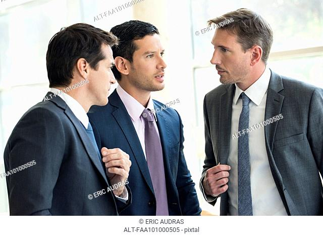 Businessmen having serious discussion