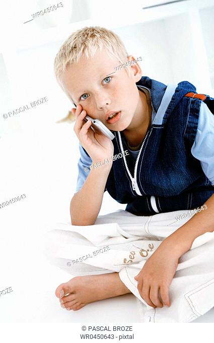 Portrait of a boy talking on a mobile phone
