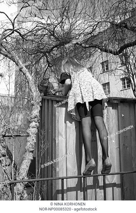 A girl beckoning a cat  Sweden