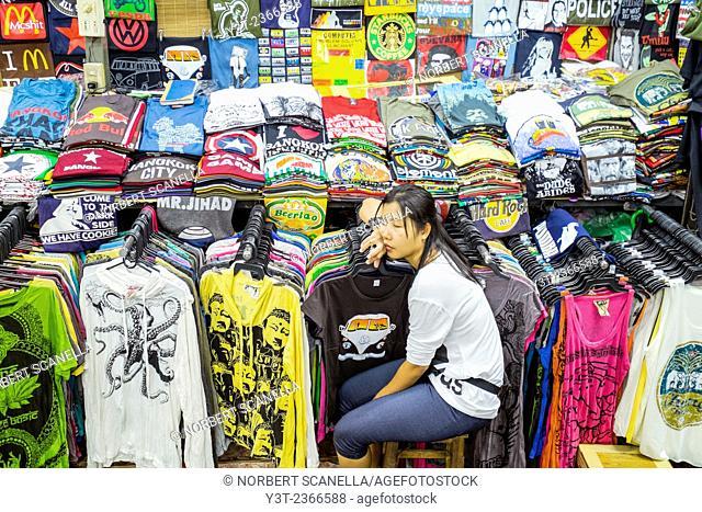 Asia. Thailand, Bangkok. Khao San Road. Saleswoman tee shirt