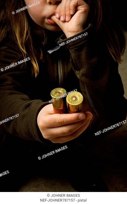 A child holding ammunition in her hands, Sweden