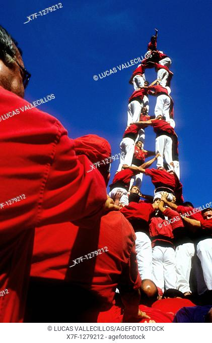 Nens del Vendrell 'Castellers' building human tower, a Catalan tradition Biannual contest  bullring Tarragona,Catalonia, Spain