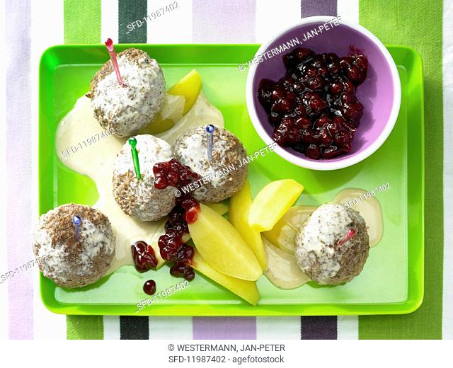 Köttbullar (Swedish meatballs) with potatoes and lingonberries