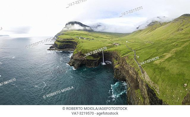 Aerial panoramic of waterfall and cliffs, Gasadalur, Vagar island, Faroe Islands, Denmark