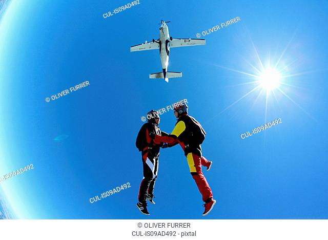Female skydivers free falling above Leutkirch, Bavaria, Germany