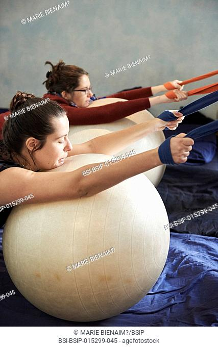 Reportage on a midwife practice in Lyon, France during antenatal classes. Future mothers discover positions enabling the relaxation and opening of the pelvis
