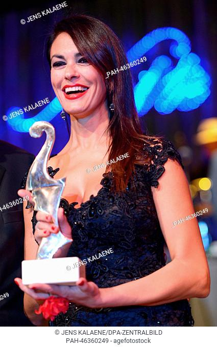 Italian actress Maria Grazia Cucinotta holds her Premio Bacco trophy during the Italian Film Ball 'Notte delle Stelle' at the 64th annual Berlin Film Festival